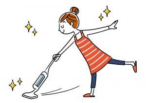 部屋を掃除する主婦